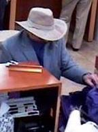 Suspect robbing the Union Bank branch at 16880 Bernardo Center Drive in San Diego, California, on Friday, November 14, 2014.