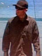 Suspect robbing the Wells Fargo Bank, 13439 Camino Canada, El Cajon, California, on Friday, November 28, 2014. The Chit Chat Bandit is also suspected of robbing the Wells Fargo Bank at 7544 Girard Avenue, La Jolla, California, on Wednesday, November 26, 2014.