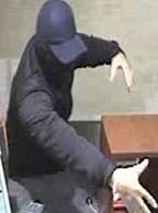 The El Chapparito Bandit is believed to be responsible for robbing 15 banks from November 2013 to September 13, 2014. Here, he is shown robbing the Chase Bank, 5303 Ruffin Road, San Diego, California, on January 15, 2014.