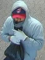 The El Chapparito Bandit is believed to be responsible for robbing 15 banks from November 2013 to September 13, 2014. Here, he is shown robbing the U.S. Bank, 9400 Mira Mesa Blvd., San Diego, California, on August 30, 2014.