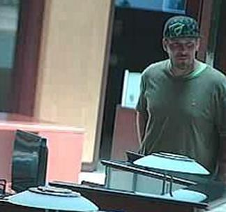 Suspect responsible for robbing the U.S. Bank branch located at 1420 Kettner Blvd. in San Diego, California, on Friday, May 9, 2014.