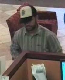 Suspect responsible for robbing the Wells Fargo Bank branch located at 10707 Camino Ruiz in San Diego, California, on Thursday, June 26, 2014.