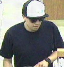 The Risky Business Bandit is believed to be responsible for robbing four banks from April 18, 2014 to Friday, July 25, 2014. Here, he is shown robbing the Wells Fargo Bank, 10535 Craftsman Way, San Diego, California, on Tuesday, May 13, 2014.