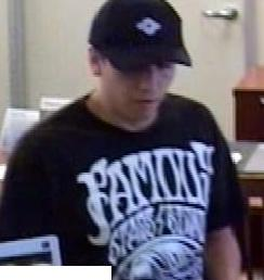 The Risky Business Bandit is believed to be responsible for robbing four banks from April 18, 2014 to Friday, July 25, 2014. Here, he is shown robbing the California Bank and Trust, 16796 Bernardo Center Drive, San Diego, California, on Tuesday, June 27, 2014.