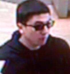 The Risky Business Bandit is believed to be responsible for robbing four banks from April 18, 2014 to Friday, July 25, 2014. Here, he is shown robbing the San Diego County Credit Union, 12330 Carmel Mountain Road, San Diego, California, Friday, July 25, 2014.
