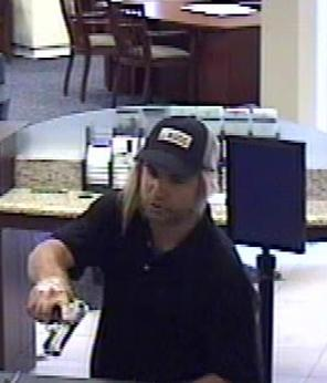 Suspect who robbed the California Bank and Trust branch located at 140 Civic Center Drive in Vista, California, on Friday, August 1, 2014.