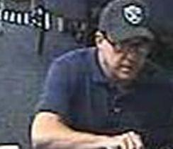 Suspect robbing the U.S. Bank, located at 7700 Carlsbad Village Drive, Carlsbad, California on Tuesday, August 5, 2014. The robber, nicknamed The Hills Bandit, also robbed three banks in the Los Angeles area; one Wells Fargo Bank in on May 16, 2014, and two Citi Banks on July 16, 2014, and July 25, 2014.