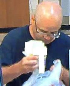 Suspect who robbed the Wells Fargo Bank branch located at 401 B Street in San Diego, California on August 18, 2014.