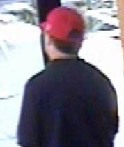Suspect robbing the California Bank and Trust, 4320 La Jolla Village Drive in San Diego, California, on Monday, August 25, 2014.