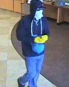 Suspect robbing the Wells Fargo Bank, located at 10707 Camino Ruiz in San Diego, California on September 13, 2014. It is believed to be the 15th bank robbery of the El Chapparito Bandit.