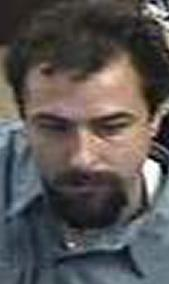 Suspect robbing the Chase Bank, located at 1641 South Melrose Drive, Vista, California, on Wednesday, October 15, 2014. The Bearded Bandit is suspected in two other bank robberies.