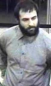 Suspect robbing the Wells Fargo Bank, 685 Saturn Boulevard, San Diego, California, on Tuesday, October 7, 2014. The Bearded Bandit is suspected in two other bank robberies.
