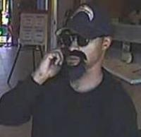 Suspect robbing the Mission Federal Credit Union, located at 269 West Washington Street, San Diego, California, on Wednesday, September 16, 2015.