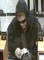 Unknown female who robbed the Chase Bank branch located at 1101 Palm Avenue in Imperial Beach, California, on Friday, December 18, 2015.