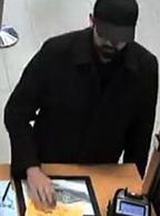 "Unknown male responsible for robbing the North Island Credit Union located at 10549 Scripps Poway Parkway in San Diego, California, on Friday, December 18, 2015. This robber has been dubbed the ""Neatly Groomed Bandit."""
