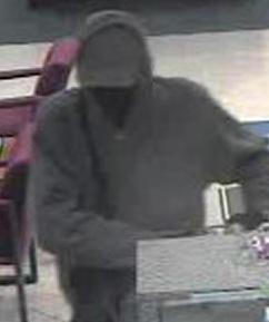 Suspect robbing the U.S. Bank branch, located at 4136 Oceanside Boulevard, Oceanside, California, on Tuesday, December 23, 2014.