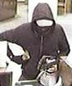 Suspect robbing the U.S. Bank branch, located at 2520 El Camino Real in Carlsbad, California, on Tuesday, January 6, 2015.