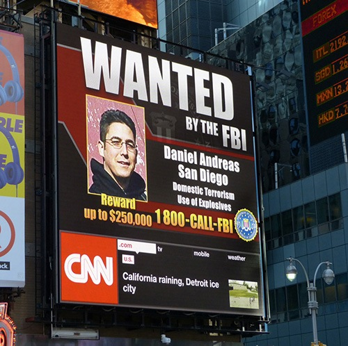 Fugitive Daniel Andreas San Diego, wanted in connection with domestic terrorism, has been featured on a billboard in Times Square in New York City.