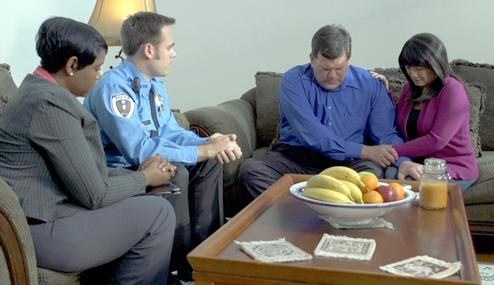 "A scene from the demonstration video embedded in the ""We Regret to Inform You..."" online training module developed jointly by the FBI and Pennsylvania State University to provide assistance to law enforcement and other first responders charged with providing death notifications to victims' next of kin."