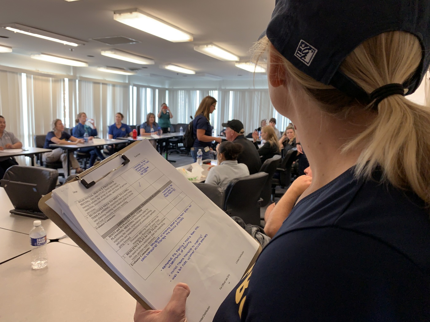 A Victim Services Division program manager evaluates students during a mock mass-casualty event September 25, 2019, at the FBI Training Academy in Quantico, Virginia. The exercise culminated ELEVATE-APB training for victim service providers.