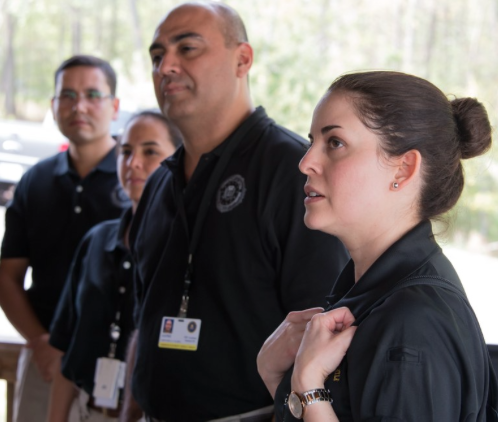 Martha Anta (right), a linguist in our San Antonio Field Office, interprets for the Spanish-speaking CACIE participants who did not speak English.