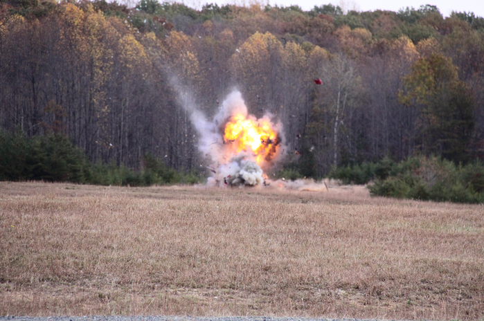 A vehicle packed with an explosive mixture and placed about 700 yards away explodes during a National Improvised Explosives Familiarization Initiative (NIEF) training exercise in 2009.