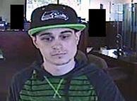 Suspect who robbed an Umpqua Bank at 1900 S. 320th Street in Federal Way, Washington on Friday, July 18, 2014.