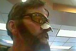 Unidentified bank robber believed to be responsible for at least six bank robberies in the city of Everett, Washington from June 1, 2015 to October 30, 2015.
