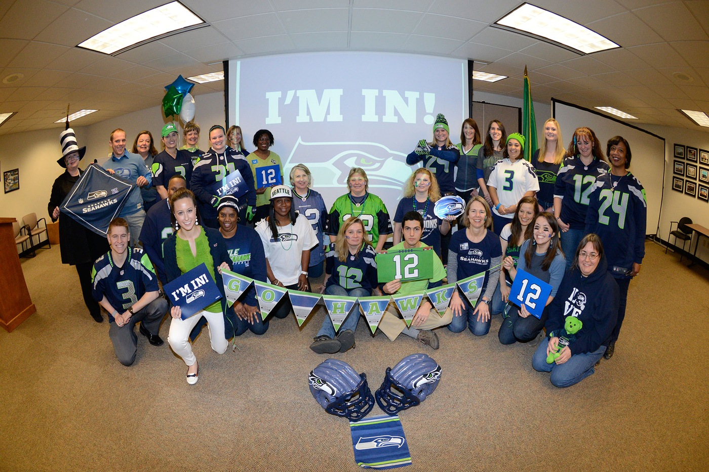Group of FBI Seattle employees support the Seattle Seahawks.