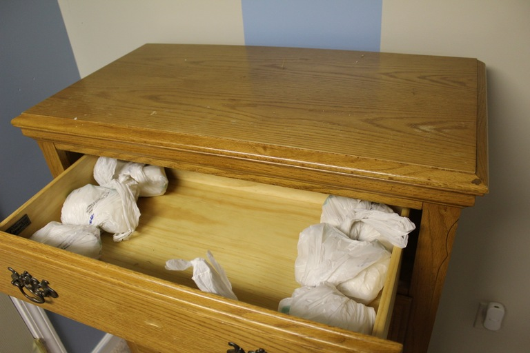 Packets of cocaine in a dresser drawer seized during a June 2017 takedown of a West Virginia drug distribution conspiracy directed by Velarian Carter.