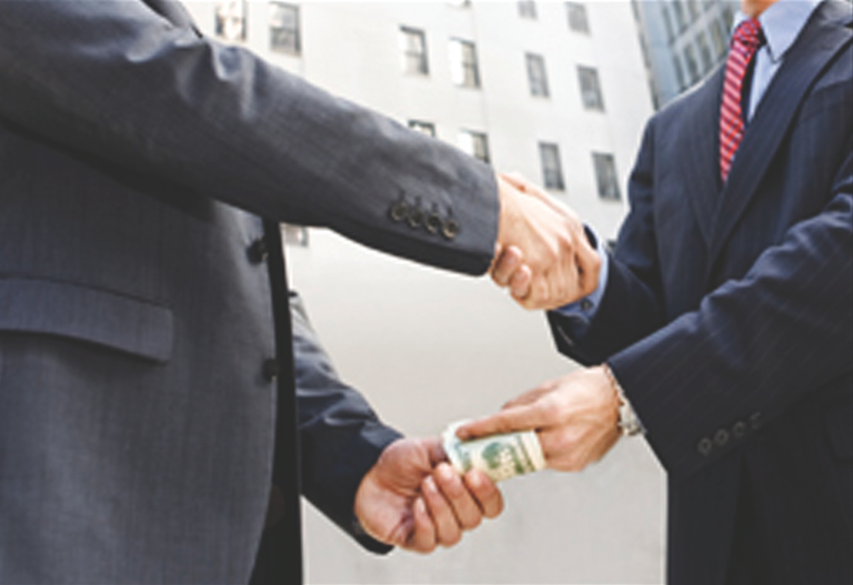 Hands Shaking and Exchanging Money (Stock Image)