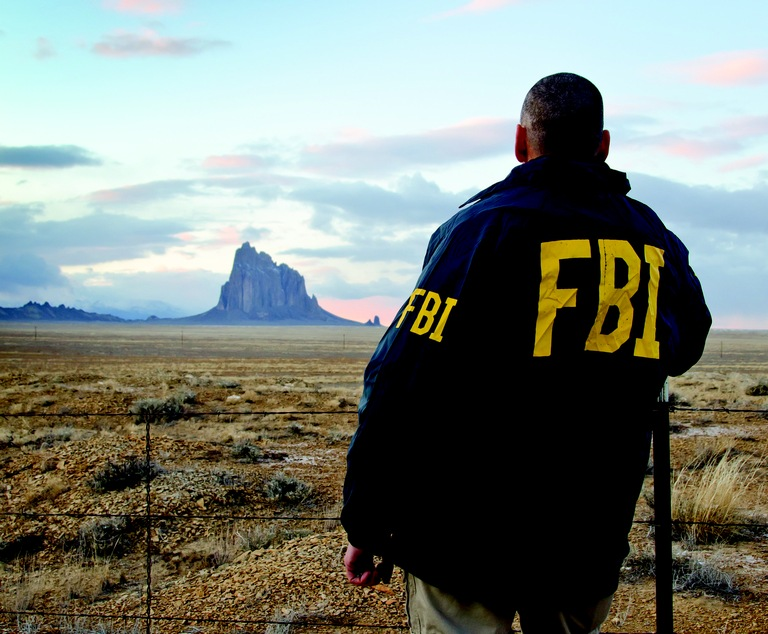 Special Agent Overlooks Shiprock Land Formation in December 2011