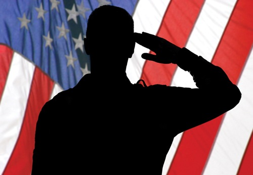 Silhouette of Saluting Soldier in Front of Flag