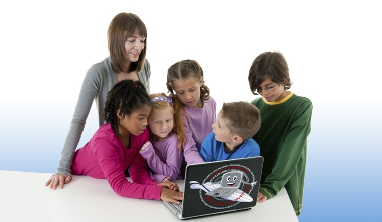 Kids gathered around a laptop for the Safe Online Surfing Internet Challenge.