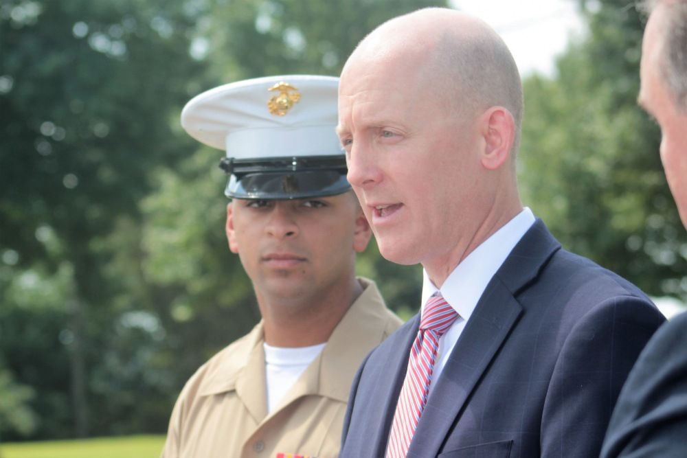U.S. Marine Cpl. Stewart Rembert and FBI Special Agent Troy Sowers speak to the media following Sowers' retirement ceremony at the FBI Field Office in Knoxville, Tennessee, August 9, 2019. Photo courtesy of U.S. Marine Corps