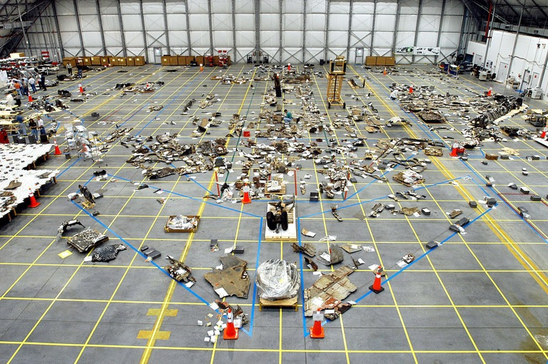 Pieces of the space shuttle Columbia, recovered after the February 1, 2003 crash, placed in a NASA hangar. (NASA Photo)