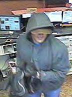 Suspect who robbed the Illini Bank branch at 1311 West Jefferson in Auburn, Illinois on April 24, 2014.
