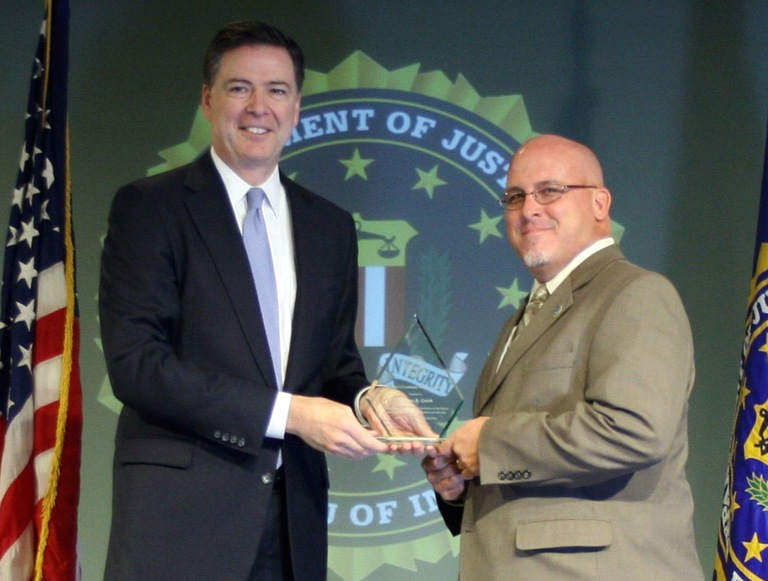 Stephen B. Quirk Receives Director's Community Leadership Award from Director Comey on April 15, 2016