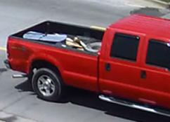 Red extended cab pick-up truck used to abduct an adult female from South County Park in Cape Girardeau on May 12, 2015. The photos were taken in Anna, Illinois. There appears to be a large dent on the rear quarter panel behind rear tire on the passenger side.