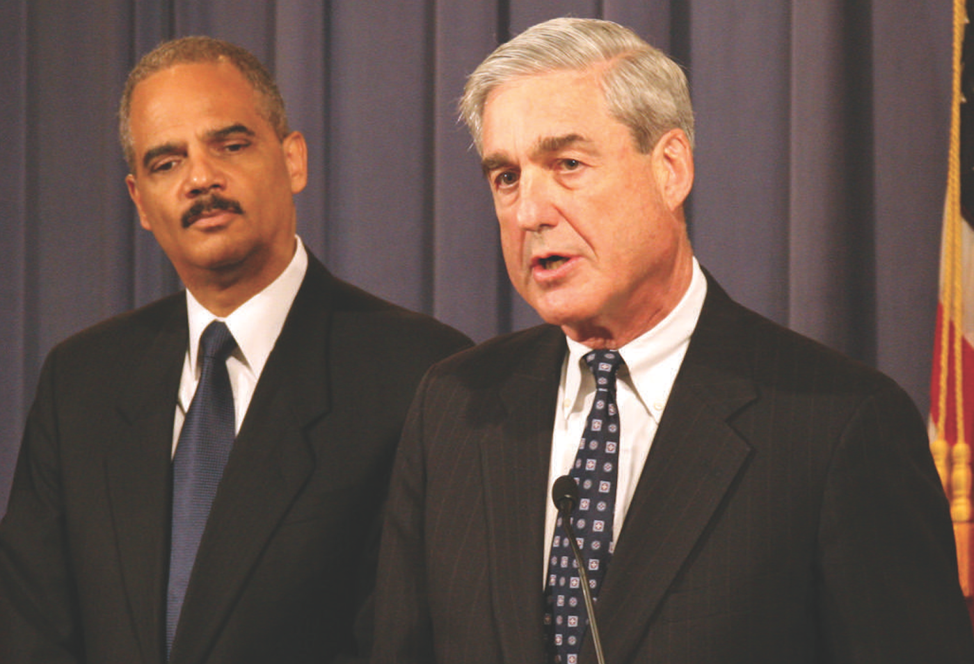 FBI Director Robert S. Mueller (right) and Attorney General Eric Holder announce arrests in a national mortgage fraud sweep called Operation Stolen Dreams on June 17, 2010.