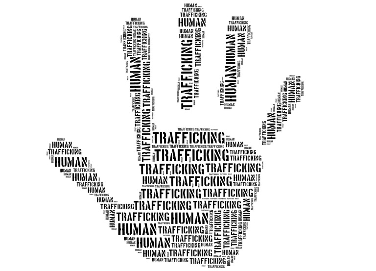 "Stock image of the shape of a hand in a stopping motion filled with text that says ""trafficking."""