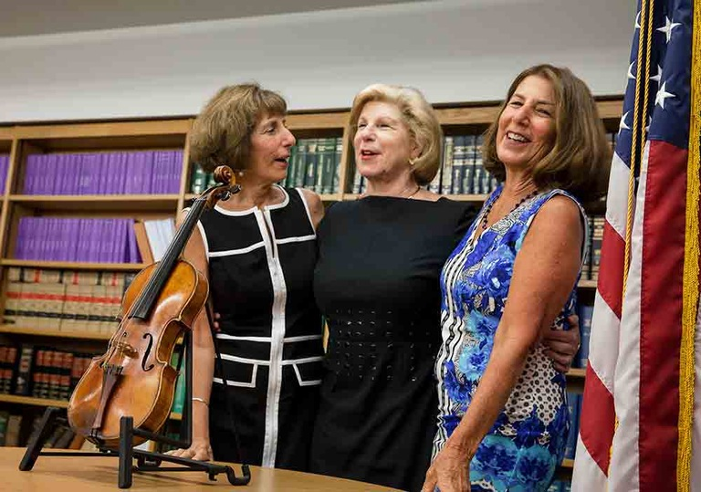 In August 2015, Jill, Nina, and Amy Totenberg celebrate the return of their father's Stradivarius violin, which was recently recovered after having been stolen in 1980.