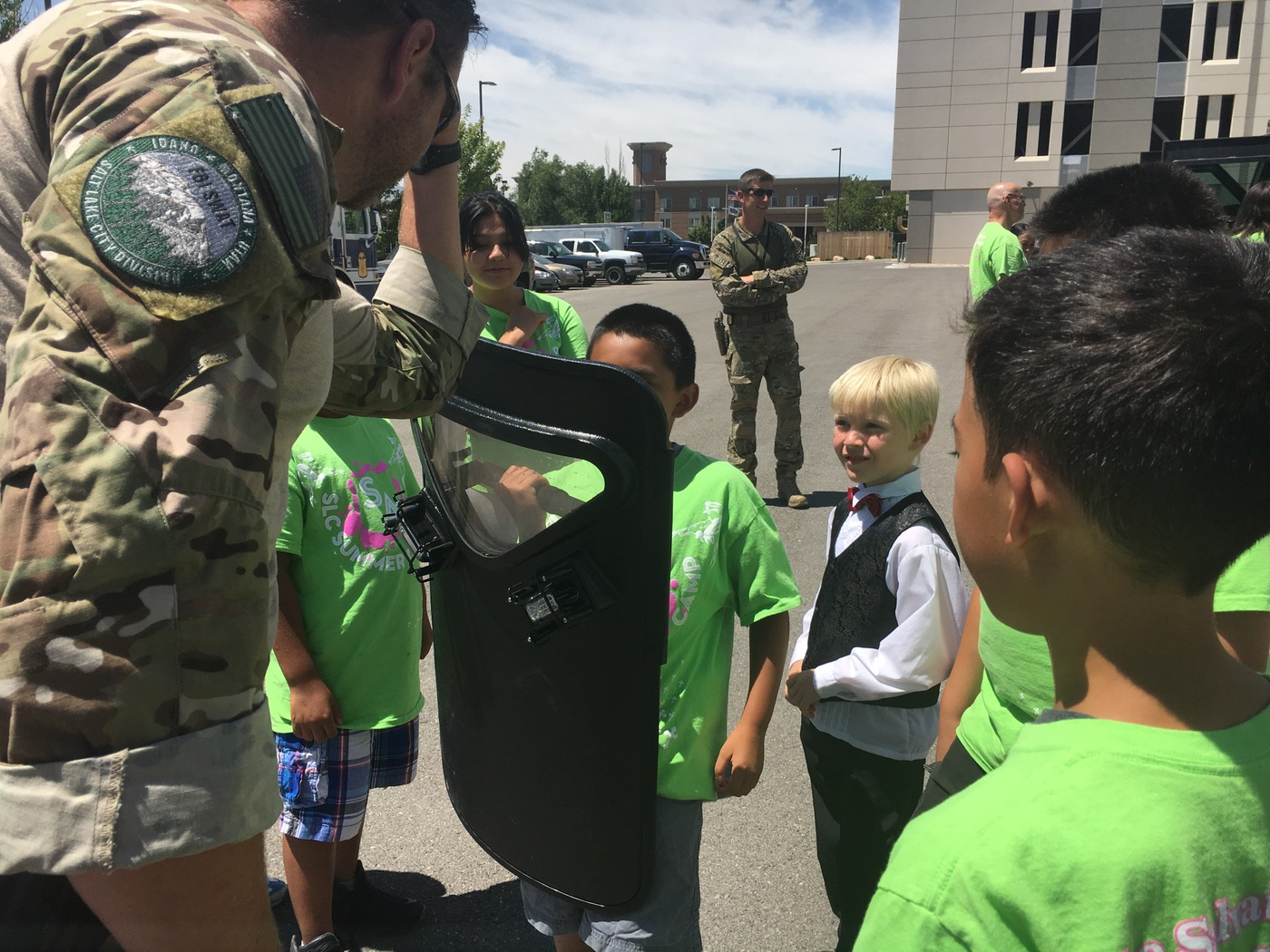 Salt Lake City Junior Special Agents try on SWAT gear.