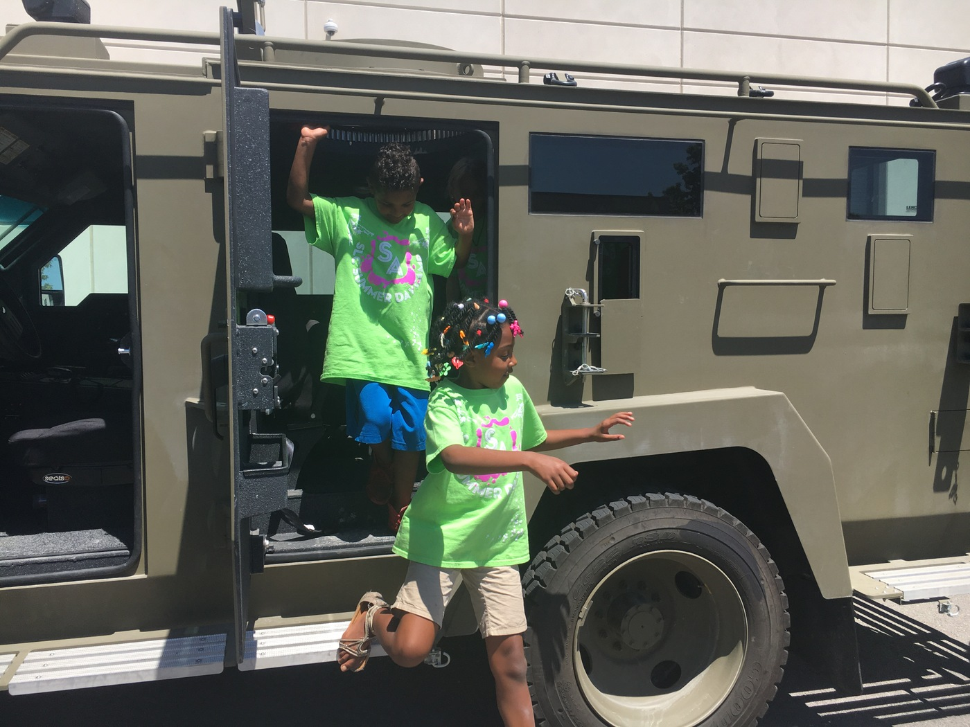 Salt Lake City Junior Special Agents explore a SWAT vehicle.