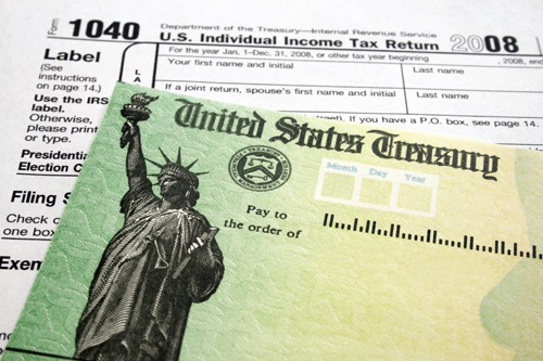 Tax Form 1040 and Refund Check