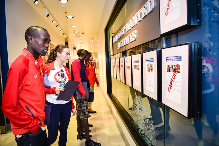 U.S. Olympic athletes tour an exhibit prior to attending a career information session at FBI Headquarters in Washington, D.C., on October 1, 2016.