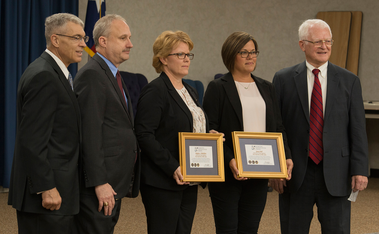 Members of the Texas Department of Public Safety receive the FBI's Biometric Identification Award on July 14, 2017 in Austin.  The Texas DPS was one of two recipients of the 2017 award. Pictured (from left to right) are Steven McGraw, Mike Lesko, Jenny Hall, and Meghan L. Blackburn (Texas DPS), and William G. McKinsey (FBI). From 10/10/17 CJIS Link article.