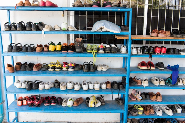 Kids' shoes are neatly stored outside the Children's Haven in Pattaya