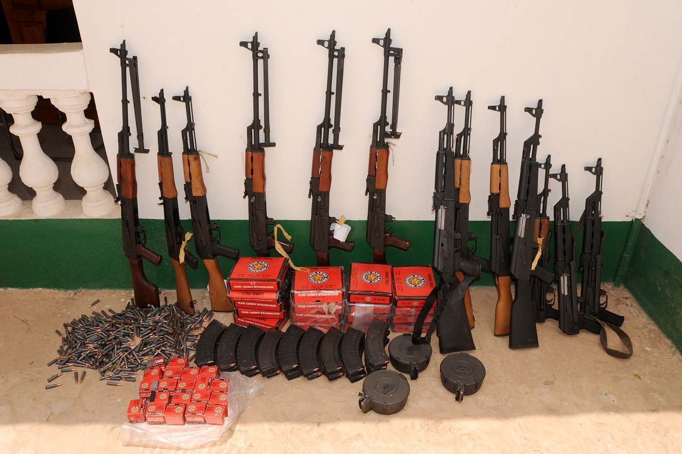 Assorted weapons and ammunition seized by Gambian soldiers after a 2014 coup that involved several naturalized Americans.