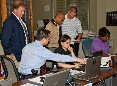 At the command post for the April Tinsley investigation, one of our agents (front left) offers instruction on ORION, our new crisis management system.